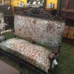 McLarens Antiques and Interiors Round Top cow-hide covered settee