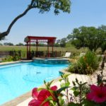 Lucky Penny Ranch Round Top relaxing pool in the pasture.